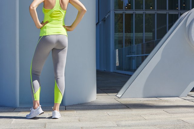 Woman body before outdoor sport in the city sunlight