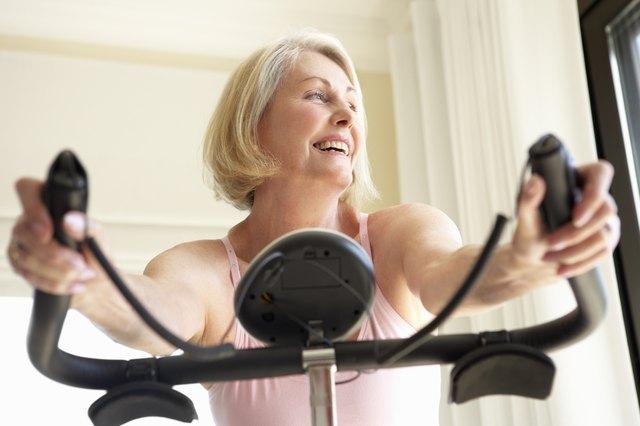 Senior Woman On Exercise Bike