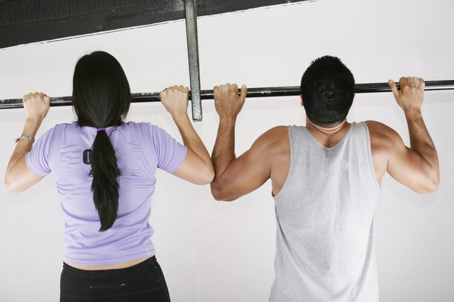 woman and man preparing to do pull ups