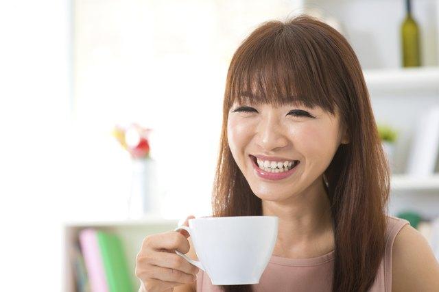 Asian woman enjoying coffee