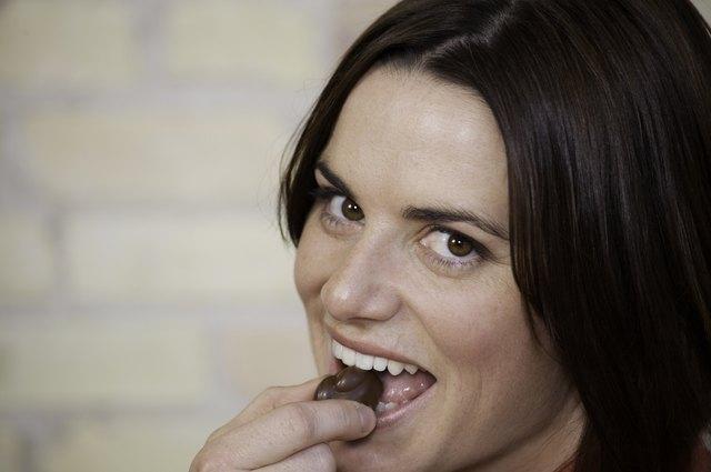 Beautiful Woman Eating Chocolate
