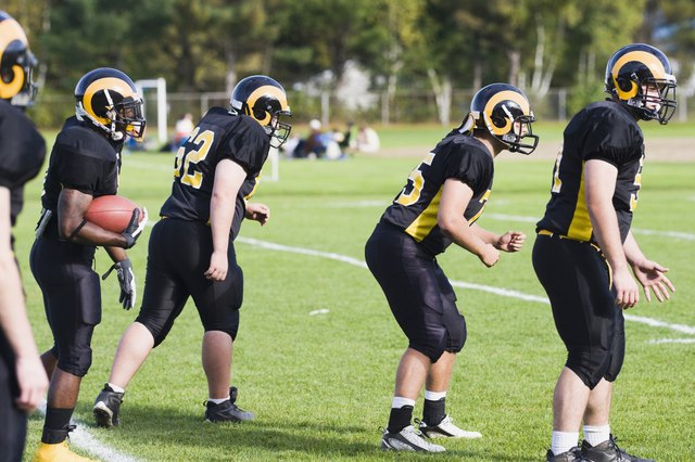Football players playing in a field