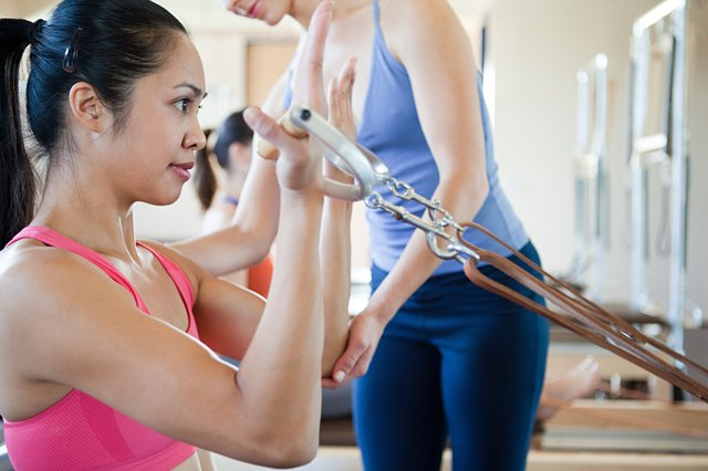 Woman doing bicep curls in pilates