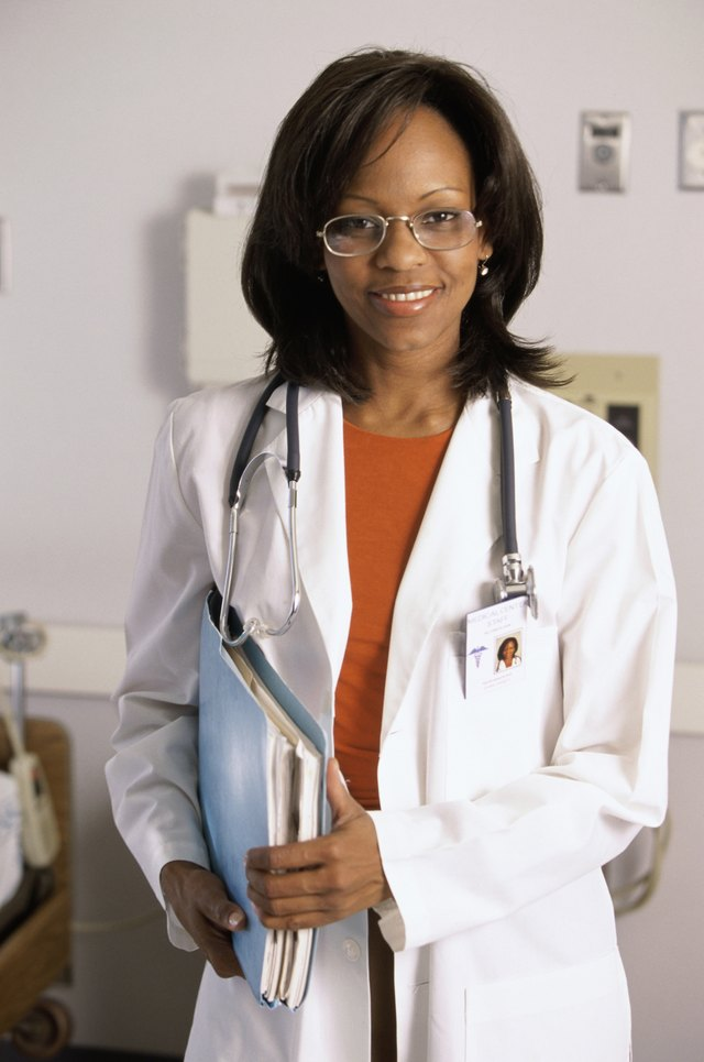 Portrait of a female doctor holding a medical record
