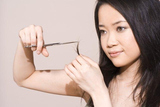Woman trimming split-ends