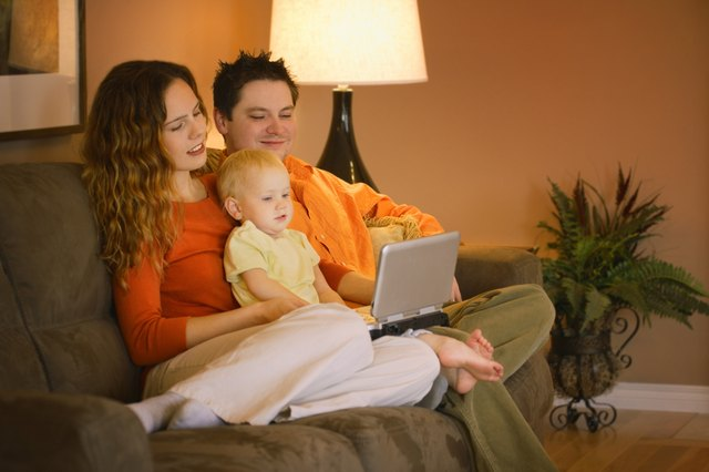 young family watching movie on portable DVD player