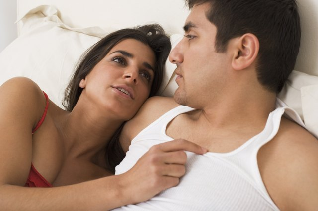 Couple lying in bed