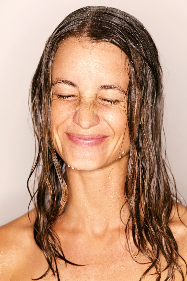 Head and shoulders shot of wet woman