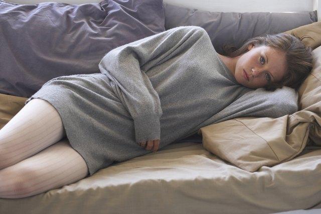 teen girl lying on sofa
