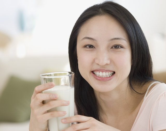 Asian woman drinking milk