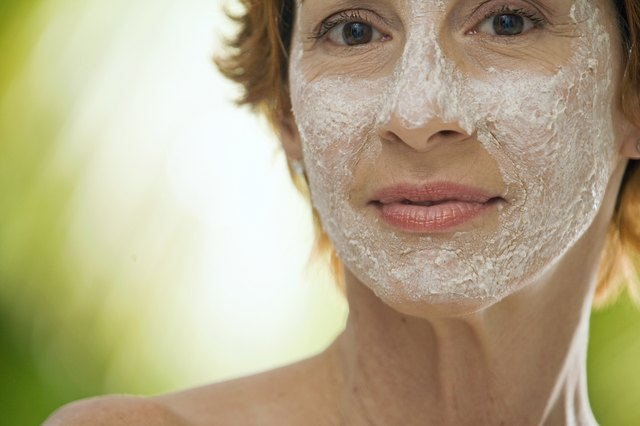 Portrait of a mature woman with a facial mask on