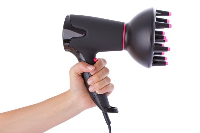 Hand holding a hairdryer