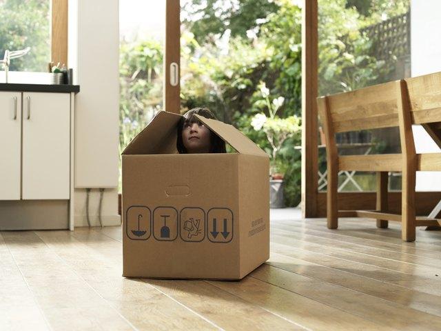 Child in cardboard box