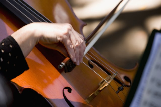 Close-up of a woman playing the cello, Balboa Park, San Diego, California, USA