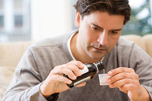 Man pouring medicine