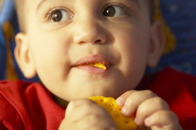 Toddler boy eating