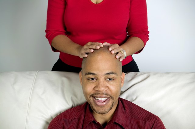 Man with a woman's hands on his head