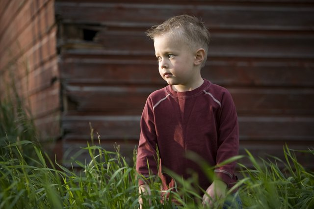 A young boy in tall grass