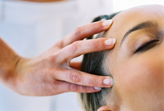 close-up of a young woman getting a head massage