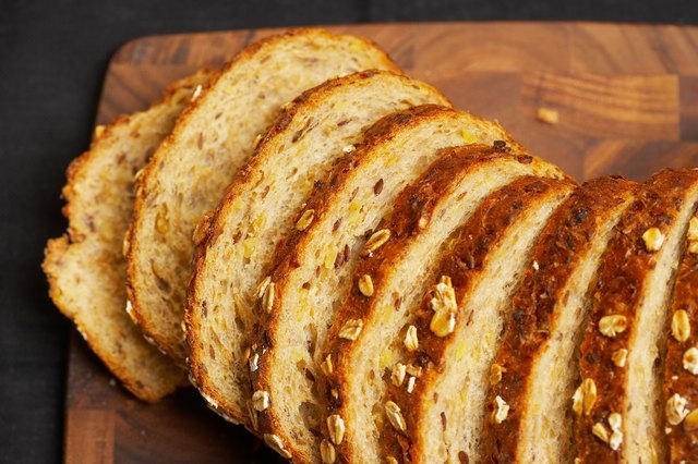 Slices of whole grain bread on cutting board