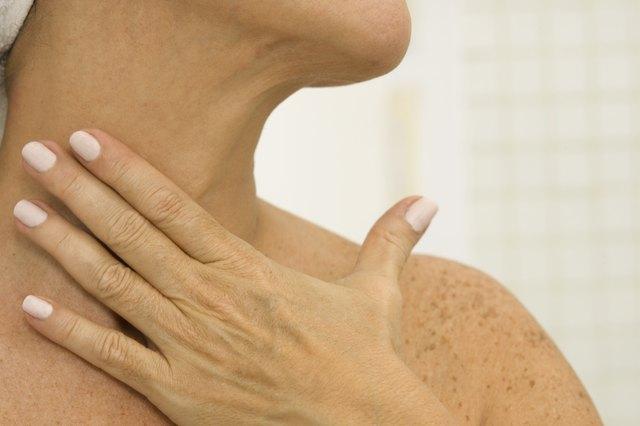 Woman massage her neck
