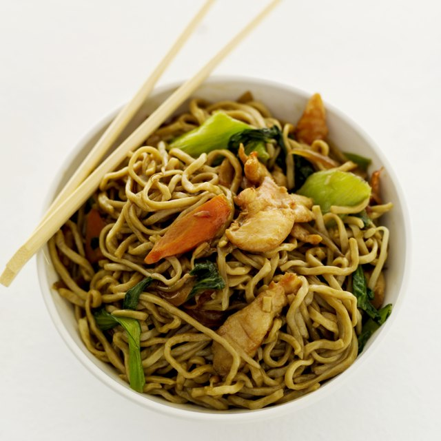 high angle view of chinese noodles in a bowl and a pair of chopsticks