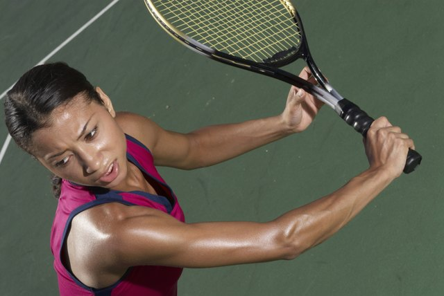Woman holding tennis racket on court