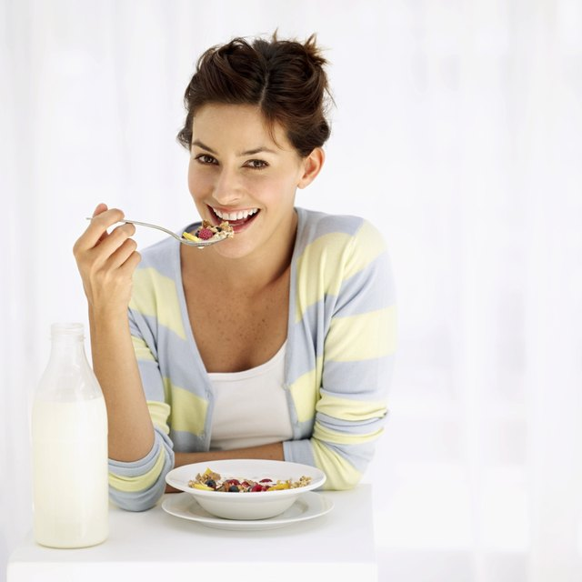 Portrait of a woman eating breakfast cereal
