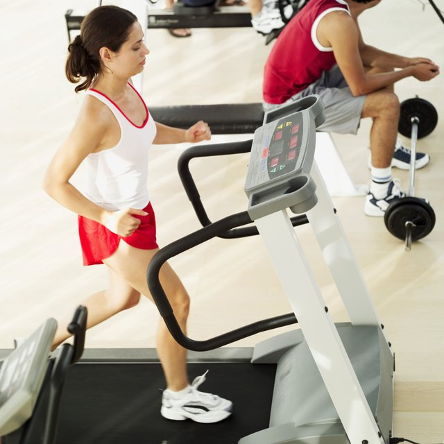elevated view of a woman running on a treadmill
