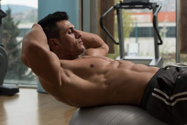 Exercising Abs Abdominals In Fitness Club