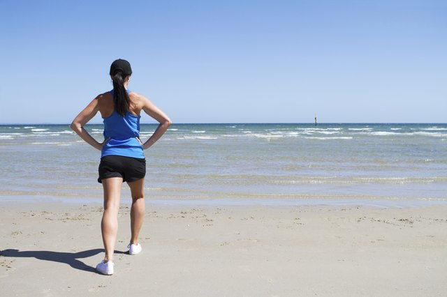 Woman exercising on a beach
