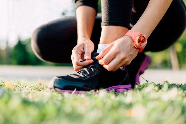 Closeup of a runner preparing his shoes for a run
