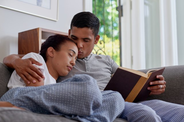husband read wife sleep