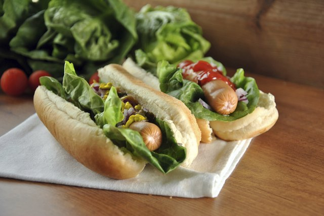 two hot dogs with salad