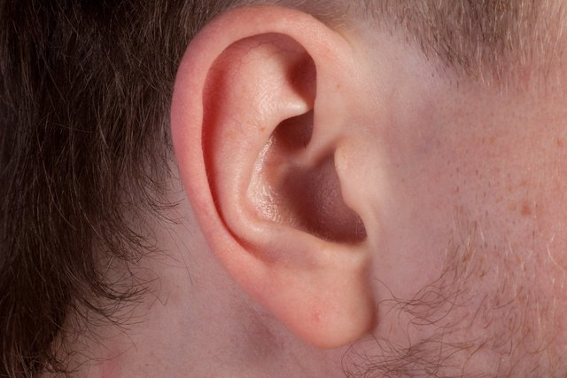 Men's ear. Close up.