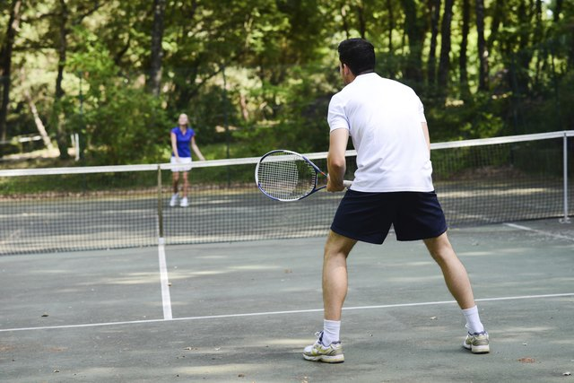 young couple playing tennis outdoor summer