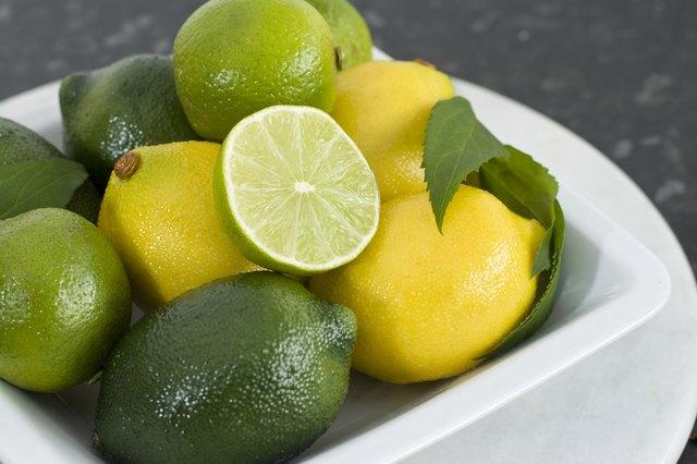 Bowl Of Fresh Lemon & Limes On Kitchen Table