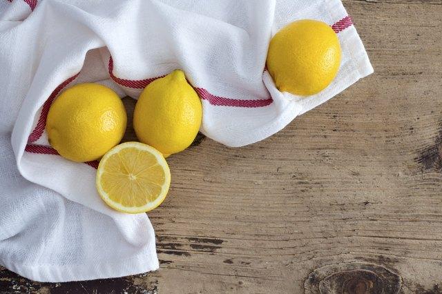 Lemon on rustic wooden background