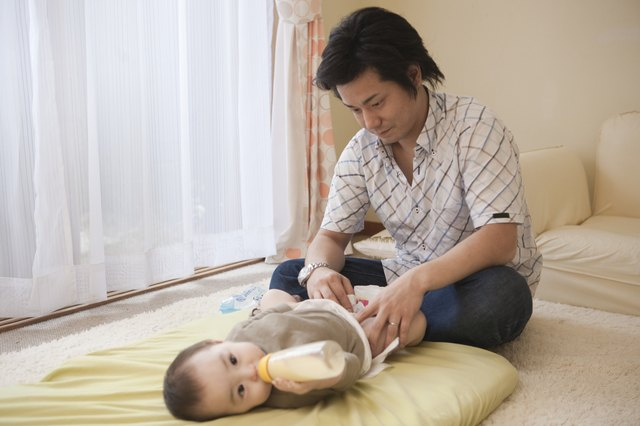Father Diapering Baby Girl