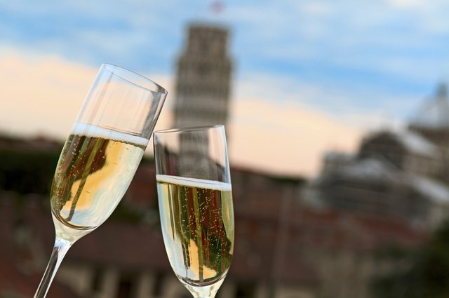 Two glasses of champagne with Pisa's Tower