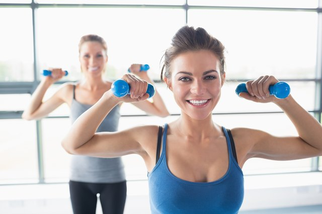 Two women lifting weights