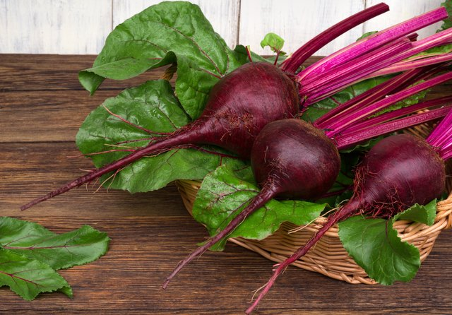 fresh beetroot with leaves on wooden table