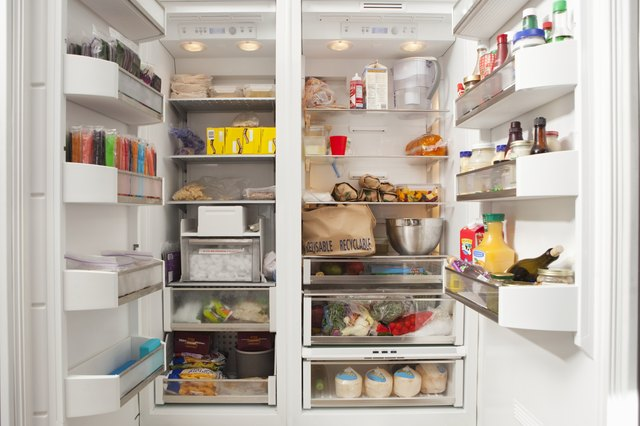 Stacked products in open fridge