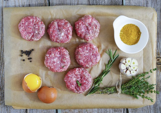 chopped steaks with rosemary, garlic, egg and thyme