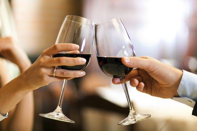 Couple toasting wine glasses