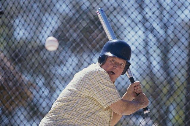 Senior man playing baseball