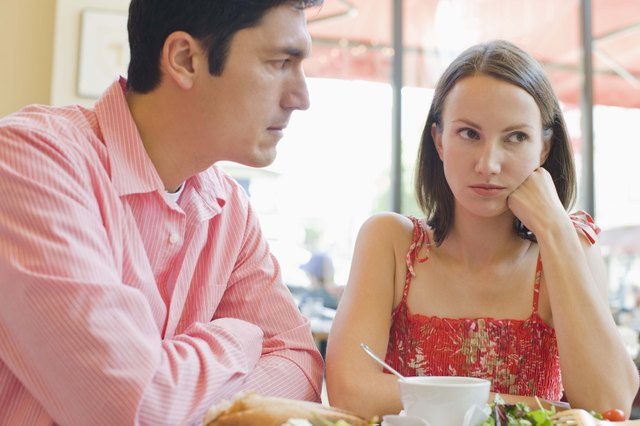 Couple arguing in cafe