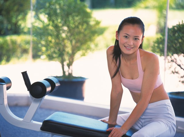 Image of a Young Adult Woman About to do Some Exercises, Looking at Camera, Smiling, Differential Focus