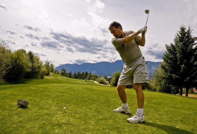 Golfer taking his first shot