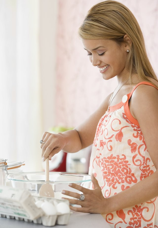 Hispanic woman baking